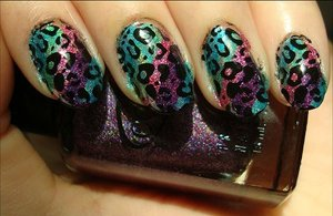 Holographic Rainbow Leopard Nails Nail tutorial & more photos here: http://www.swatchandlearn.com/nail-art-tutorial-holographic-rainbow-leopard-konadicure/