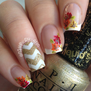 I did this fall nail design since the first official day of fall was last week! I know that this design isn't perfect, but it was my first time doing freehand French tips and even though the leaves aren't great either I think you all still get the idea of what they are supposed to be. More info here: http://www.nails-by-erin.com/2014/09/fall-leaves-nails.html