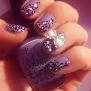 Purple nails with leopard print and a big shiny bow   ;)