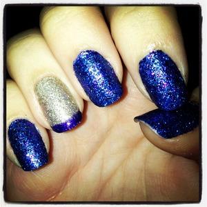 Glitter manicure with purple tip