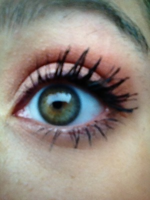 Grey eye liner, peach colored eye shadow