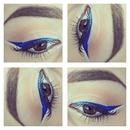 Blue eyeliner and glitter.