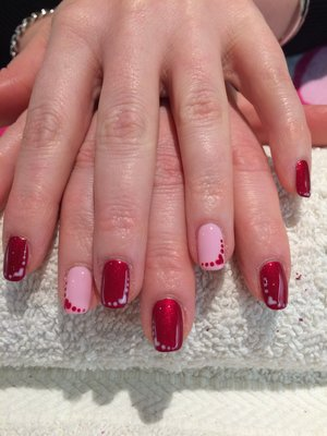 Red and Pink valentines nails.  #nailart #gelpolish #handpainted