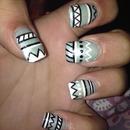 Sky blue Aztec nails