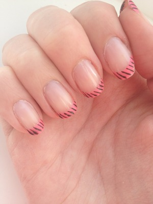 Matte neon pink tips with black stripes over glossy nude polish :)