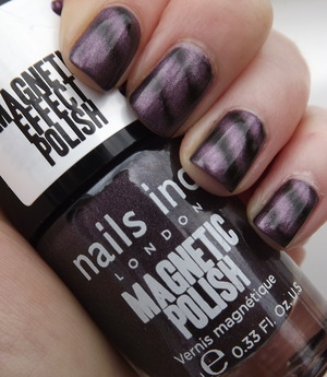 A deep grey toned purple magentic effect polish
