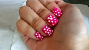I did this a while back but i uploaded it recently because I thought it seems suitable for valentines day? This is my polka dot nail design! I have a video on how I did it (: