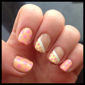 Colorful spring mani with pink and orange polka dots and 2 accent fingers.