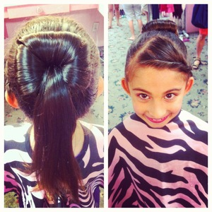 a 3/4 bun with the bangs twisted and pinned down.