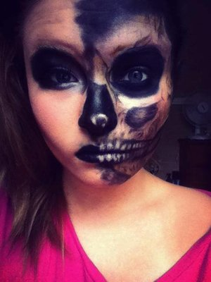 I used liquid eye liner, black eye shadow, silver for the inner part of the eye, and white face paint for the teeth.
