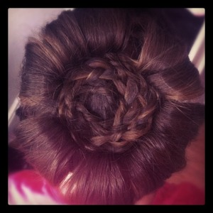 Experimenting!!! From the front this just looks like a high bun, this pic is taken from above!