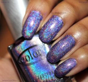 A medium blue-leaning purple linear holo.