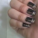 plaid nail art with silver and gold glitter