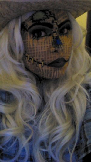 A scarecrow done in face paint