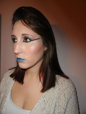 An older makeup look that I did. Blue pigment on the lips (would have used Lip Tar if I had it at the time!) with dramatic eyeliner and very glowy skin