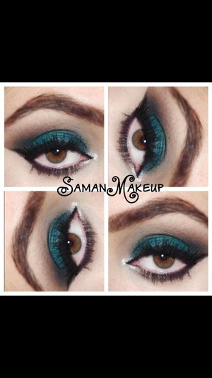 A matte emerald green smokey eye with a pop of shimmer in the tear duct..look can easily be substituted with any color,perfect eyes for any occasion!!