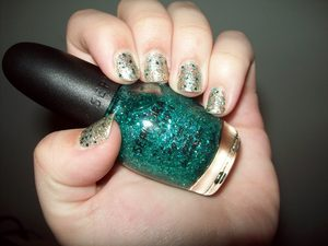 """I've always been told that I have """"mermaid hair,"""" so I wanted to do some nails to further prove my mermaid-ness. :-) For all you land-lovers who want to bring some magical sea life to your nails, here you go! This is, literally, nothing but sparkles. Which is why it's so magical <3 Base: ICING nail polish- Glimmer Gold Sparkles: Funky Fingers- Golden Coast Turquoise Sparkles: Sephora by O.P.I.: Not Your Average Turquoise"""