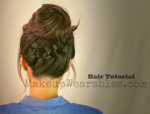 Braided ponytail into a perfect messy bun hair tutorial can be found here.