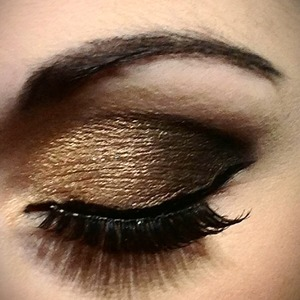 Gold to black smokey eye with strip lashes