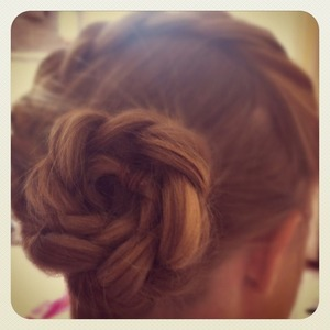 A French plait twisted round at the bottom of the hairline, looks great if you add hair jewels