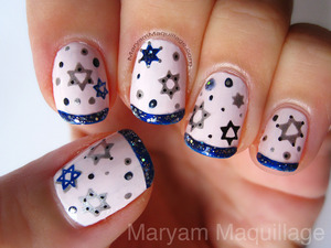 an oldie, but a goody: http://www.maryammaquillage.com/2011/12/hanukkah-snowflakes-nails.html