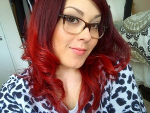 Hey everyone!! SO, this is my newest hairdo/color!  I am currently in the process of growing my hair, and it has grown into this beautiful red ombre.  I originally had to lighten all of hair to go red, and had a bad experience.  Needless to say I'm allergic to lightener on my scalp.  So, I started to just use color on my roots that didn't come with any side effects!  So as my hair has grown the lighter ends have moved lower, and I now have this unintentional, but totally lovable red ombre.   I'm still using the same color Topchic by Goldwell in 6VV at the roots, AND I started to used Pravana Chromasilk Vivids in Red all over.  The red is much, much more vibrant and creates a beautiful hues of red in my hair.  Another plus is that it is also ammonia and peroxide free.  It has nourishing silk and keratin proteins...win, win!!  I'm totally in love with my new color, and length, and I hope this helps inspire someone else!  P.S. Products I am currently using in my hair. Shampoo/Conditioner: Bed Head Urban Anti-dotes Damage Level 1 Hair Mask: It's a 10 Miracle Mask Leave in Serum/Thermal Protectant: It's a 10 Miracle Oil plus Keratin Thermal Protectant: It's a 10 Miracle Shine Spray