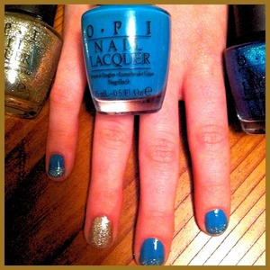 Blue with turquoise faded tips and gold accent nail