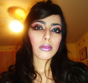 It was late at night and I was in a dark mood so this is the result of that! lol Just a really dramatic cat eye with Pinky reddish shadow on the eyes, silver, purple and pink on the lips!