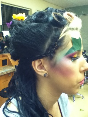 cornrow braid, pinned up and teased on the side