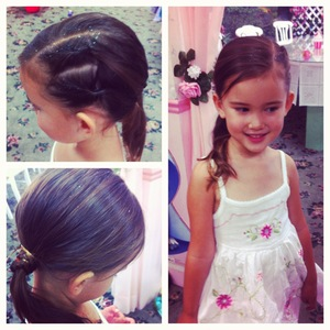 2 side twisties on the left and side swooped to a right side ponytail and small braid wrapped around the elastic. This photo was taken 2 and a half hours, after i did her hair. Add a flower to make it more elgent for weddings or special events. Or keep it simple and cute.