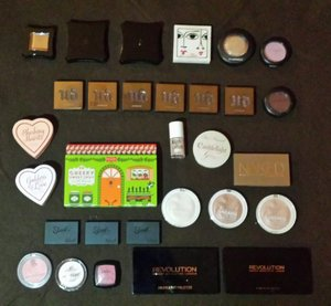 my collection of blushers and highlighters with the lids closed