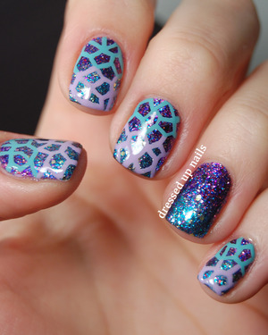 The glitters are both Shimmer Polishes and I freehanded the pattern with a little brush. I LOVE GLITTER.  http://www.dressedupnails.com/2013/02/geometric-challenge-day-7-polygon.html