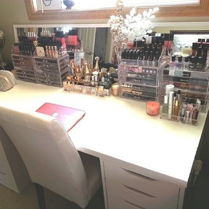 If you want a desk/vanity like this buy a basic white table top from Ikea, like the Linnmon one, then buy two Alex 5 drawer units to place underneath. Super affordable and looks really nice for makeup storage.