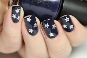 OPI Road House Blues with silver nail art stars.