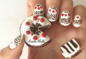 A super easy black forest cake nail art design! Tutorial here: https://www.youtube.com/watch?v=3InMqGRq37c