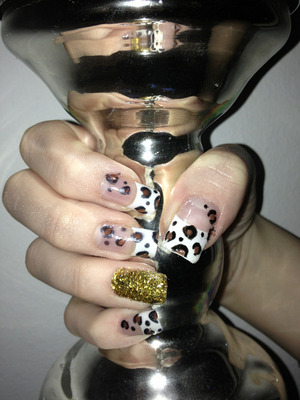 Brown leopard nails with gold glitter. Gel nails
