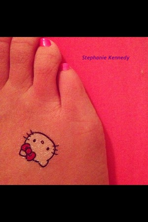 Cute Fake Hello Kitty tattoo. It only lasted a few hours, but still cute. =^_^=