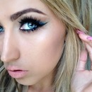 Blue shadow with a winged out liner 💙