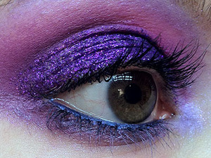 I've been dying to use my Eye Kandy Sour Grape sprinkles and my new Inglot gel eyeliner, so I threw this look together. My boyfriend said it looked like a Merlin type thing, so I called it Purple Magic!