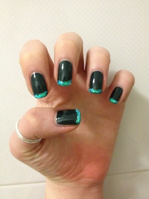 Dark green nails with glitter french