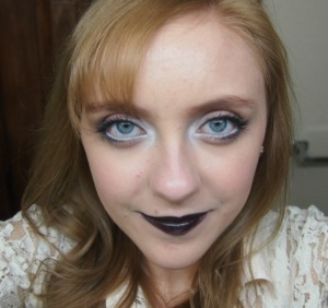 I was working this bright eye makeup and black lips today!