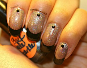 This is Black Hole Sparkle by Dainty Digits! I decided to do black french mani with this one. ^_^ As you can see it makes a great base for one! I used one coat of Black Hole Sparkle for the base, the black tips were black acrylic paint, and the black rhinestones are from Amazon. :)