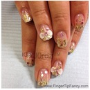 Gold nails with light pink hologram