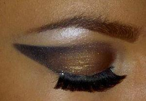 sharp pointed black and gold x