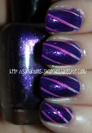 http://samariums-swatches.blogspot.com/2011/08/purple-pink-tape-mani.html
