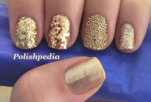 I absolutely love how this design turned out.  You can watch my video tutorial for these nails @ http://www.polishpedia.com/gold-glitter-nails.html