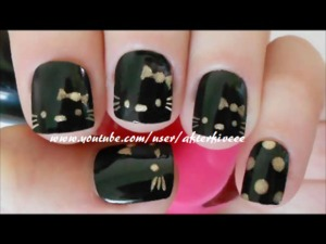 Cute and easy Hello Kitty nails with black and gold polishes =)
