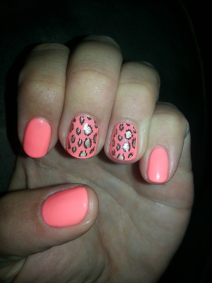 """I used gelish brand gel polish color  """"brighter than you"""" and nail stickers with cheetah design"""