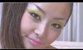 Makeup yellow eye-shadow with clear crystal