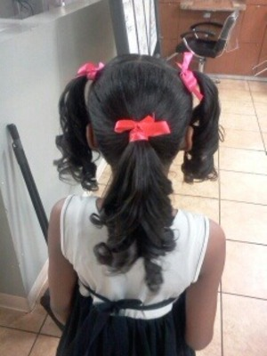 a friends daughter came in for a wash, blowdry, flat iron and curls into some ponytails!
